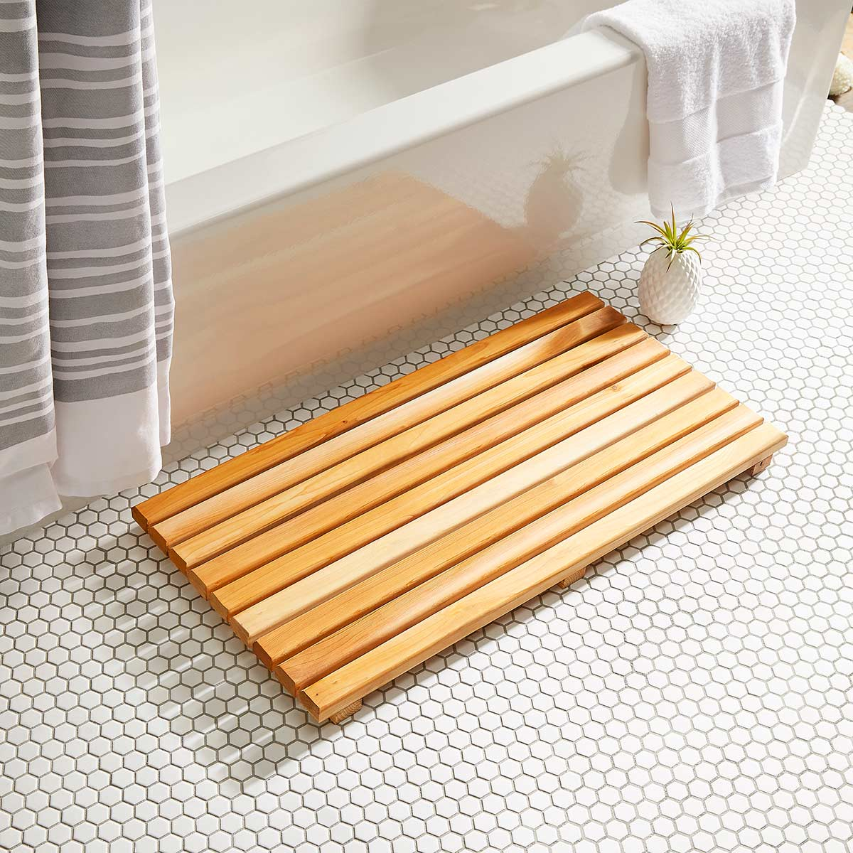 wooden bathmat made from plyco's bamboo plywood